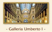 Gallery Umberto I, Naples Italy: Opposite the San Carlo is the grandest interior in southern Italy, the Galleria Umberto I. This great glass-roofed arcade, perhaps the largest in the world, was begun in 1887, nine years after the Galleria Vittorio Emanuele in Milan. The arcade is cross-shaped, with a pretty mosaic of the zodiac on the floor at the centre, and its arching dome is 184ft tall. The Neapolitans do not seem to like it as much as they once did: even at high noon, you are likely to find its vast spaces deserted but for a few small clouds of forceful, grey-suited men arguing politics around the entrances.