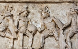 Bas relief of gladiators fighting